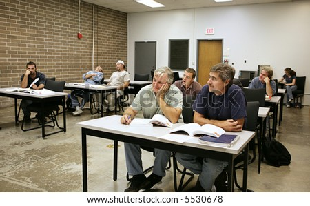 A classroom filled with very bored adult education students. - stock photo
