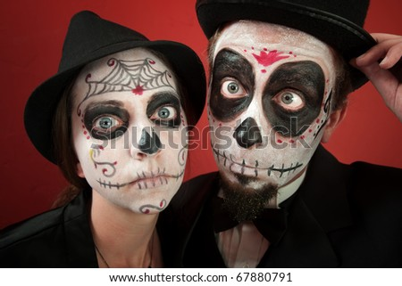 A Classy Couple wearing skull make-up for All Souls Day - stock photo