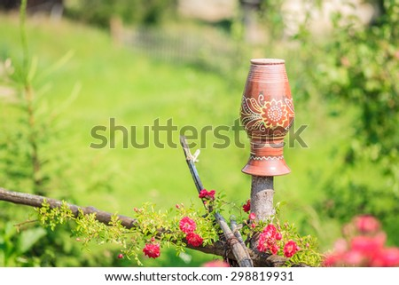 a clay jug on a fence Ukraine