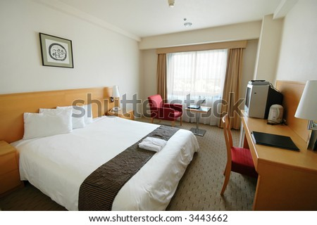 A clean and spartan hotel room - stock photo