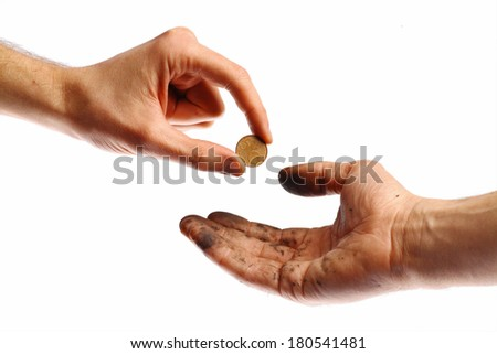 A clean hand offering a coin to a dirty hand. - stock photo