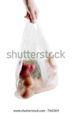 A clear plastic grocery bag filled with vegetables, a healthy choice - stock photo