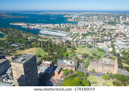 A clear sunny day in Sydney, looking east over Hyde Park at St Mary's cathedral. - stock photo