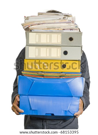 A clerk carrying a huge stack of boxes, folders, binders and papers, which hide him, isolated over white background - stock photo