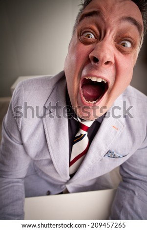 A clerk pooped in a business overflow, exploding because of the stress and pressure - stock photo