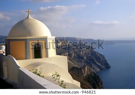 A cliffside chapel in Santorini, Greece. - stock photo