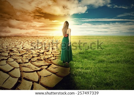 A Climate Change Concept Image. Landscape of a green grass and extreme dry drought land  - stock photo