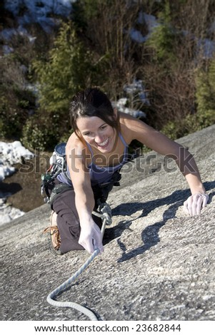 A climber on a rack face in Squamish, BC. - stock photo