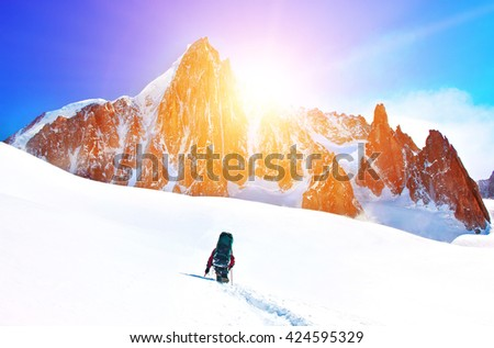 A climber reaching the summit