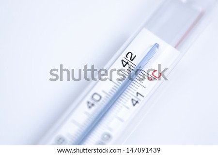 A clinical thermometer showing high and unhealthy body temperature of 42 degrees Celsius.