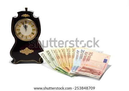 A clock and banknotes - stock photo