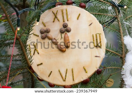 A clock decorate the Christmas tree - stock photo