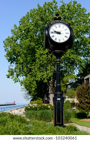 a clock in south haven at the inlet from lake michigan - stock photo