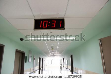 A clock in the hospital corridor. - stock photo