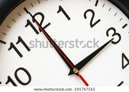 A clock with the time being three am. - stock photo