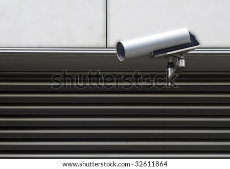 A close circuit camera on an industrial building - stock photo