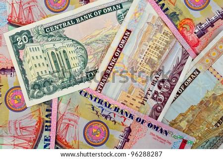 A close look at a collection of banknotes (Omani Riyals) - stock photo