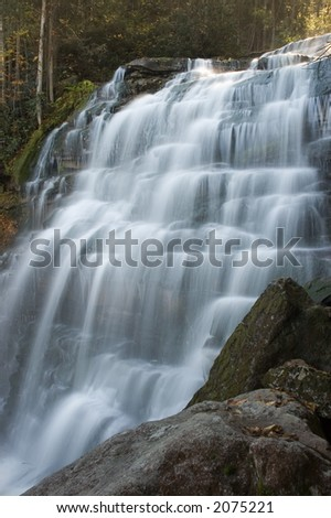 A close look at a small secluded waterfall in the forests of West Virginia. I like this type of waterfall with its many ledges for the water to tumble across. - stock photo