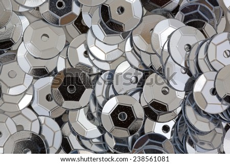 A close overhead view of silver sequins. - stock photo