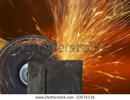 a close picture of a sparks on grinded steel
