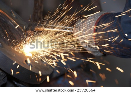 a close picture of a torch cutting steel - stock photo