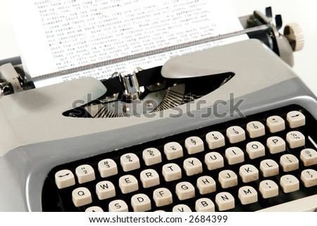 A close shot of an old typewriter - stock photo