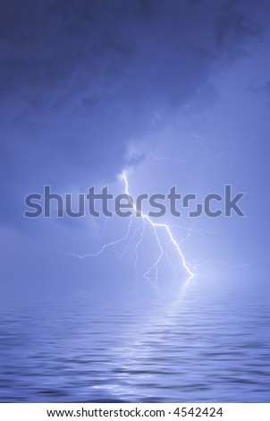 A close strike over water with reflection - stock photo