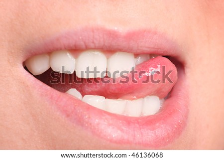 A Close up a smiling mouth of the girl - stock photo