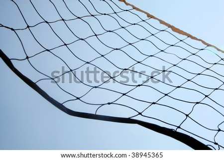 A close up beach volley ball net in front of sky. - stock photo
