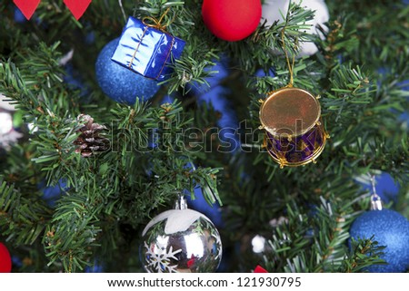 a close up christmas toys on a tree