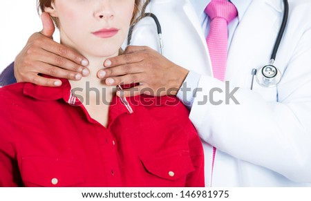 A close-up cropped image of a doctor performing physical exam, palpation of the thyroid gland. Male doctor and female patient, isolated on a white background