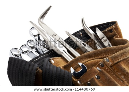 A close-up cropped image of workers belt with construction tools isolated on white