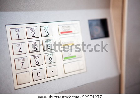 A close up detail of an outdoor bank machine; shallow depth of field with critical focus on middle row of numbers - stock photo