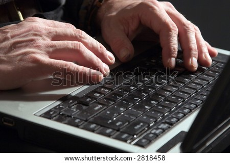 A close-up from a man's hand while working on a laptop - stock photo