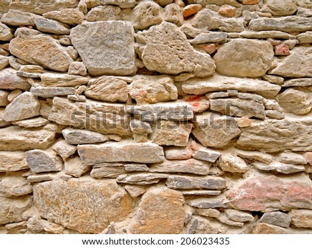 A close-up image of a stonewall - stock photo