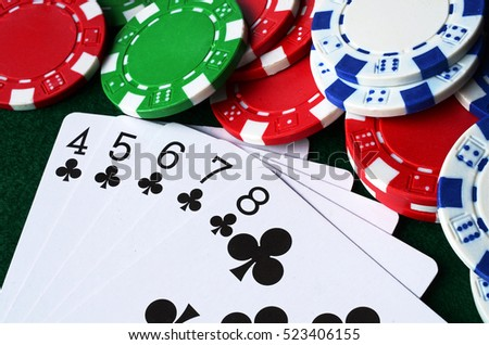 A close up image of playing cards and poker chips.