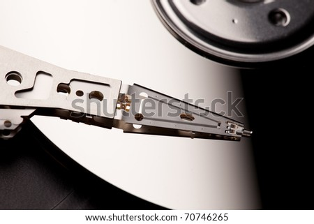 A close-up image of the read & write head of an Hard Disc Drive against the platter. / THE HDD - stock photo