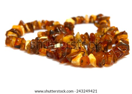 A close-up look on a amber necklace - stock photo