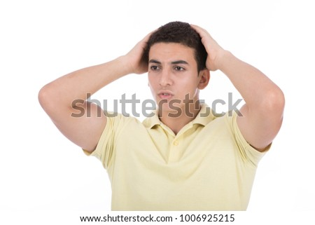A close-up medium shot of a puzzled guy out of regret or surprise, isolated on white background.