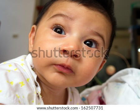 A close up of a baby girl - stock photo