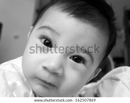 A close up of a baby girl. - stock photo