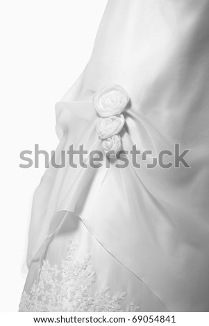 A close-up of a beautiful white wedding gown - stock photo