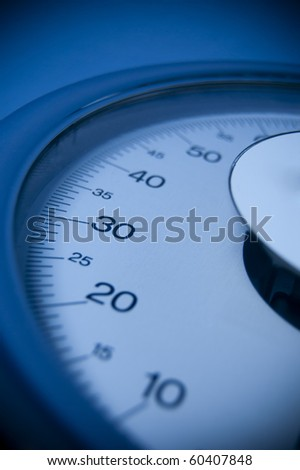 A close up of a blue weight scale