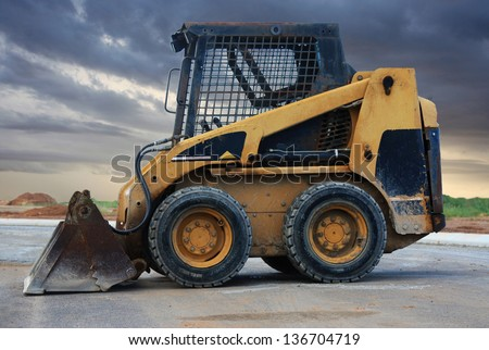 a close up of a bobcat or a skid loader - stock photo