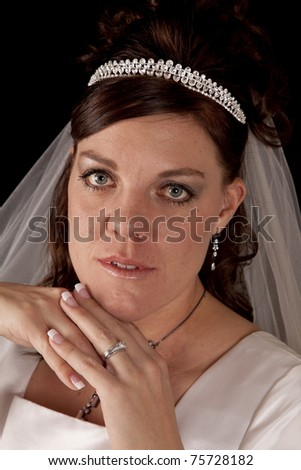 A close up of a bride's face with a small smile.