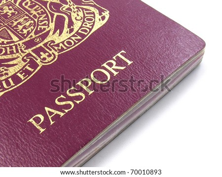A close up of a British passport on a white background - stock photo