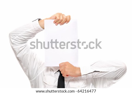 A close-up of a businessman hiding behind a sheet of white paper, alot of space to put text - stock photo