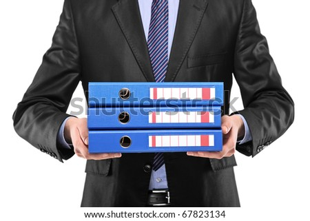 A close up of a businessman holding three blue folders isolated on white background