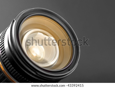 A close-up of a camera zoom lens - stock photo