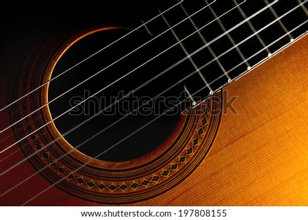 a close-up of a classic guitar - stock photo